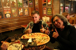 Greg and Mark enjoying some awesome pizza